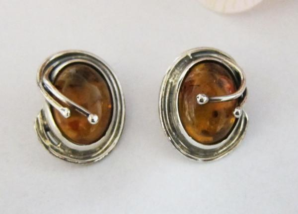 These Clic Style Honey Amber Earrings Are Clip On And Set In Sterling Silver